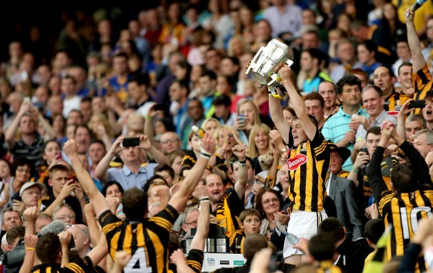 Lester Ryan lifts the Liam McCarthy Cup