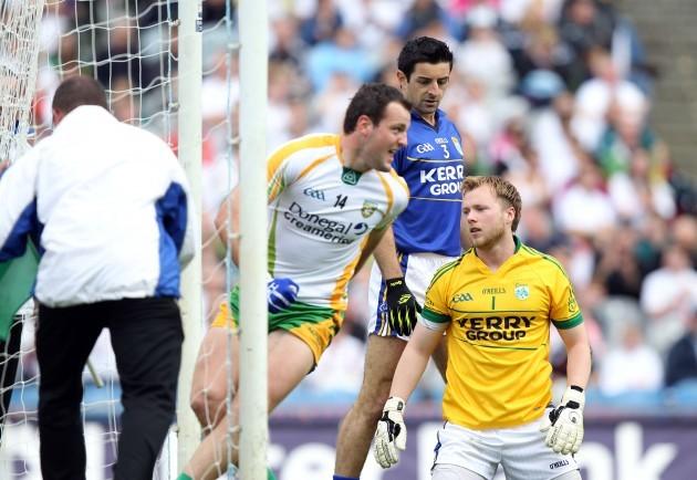 Brendan Kealy and Aidan O'Mahony look on as Michael Murphy celebrates a goal
