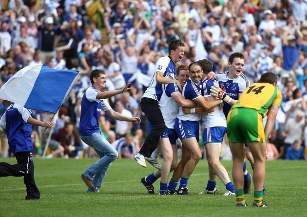 Monaghan players are mobbed by ecstatic supporters after the game