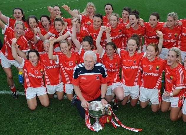 The Cork team and Eamonn Ryan with the cup after the game