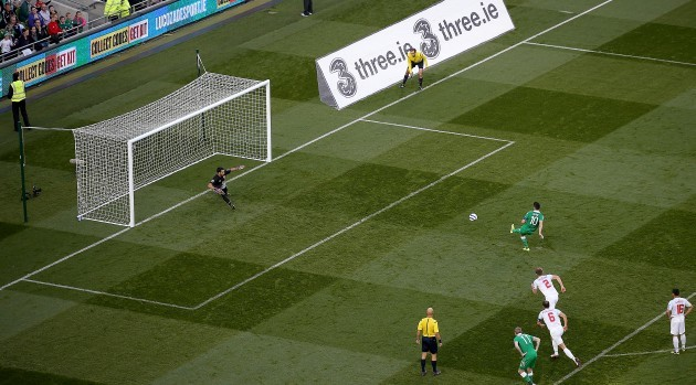 Robbie Keane scores his third goal from the penalty spot