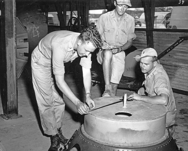 soldiers-check-the-casings-on-the-fat-man-atomic-bomb-multiple-test-bombs-were-created-on-tinian-island-all-were-roughly-identical-to-an-operational-bomb-even-though-they-lacked-the-necessary-equipment-to-deto