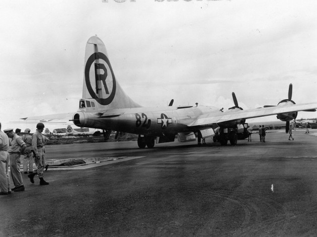 once-little-boy-is-ready-the-enola-gay-a-boeing-b-29-superfortress-bomber-is-reversed-and-positioned-over-the-trench
