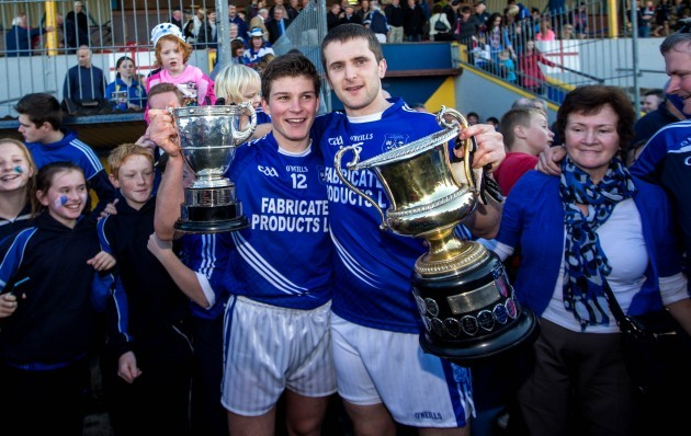 Liam Markham and Michael Hawes celebrate with the trophies after the game