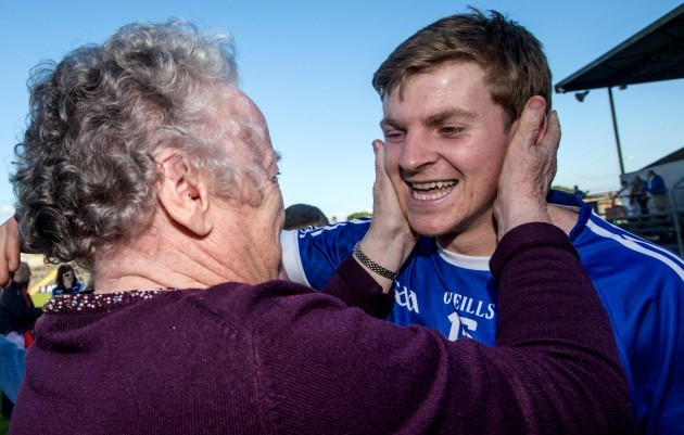Padraic Collins celebrates with his granny Annette Collins after the game