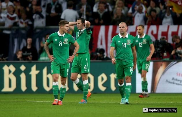 Jeff Hendrick, John O'Shea and Darron Gibson dejected after Germany score