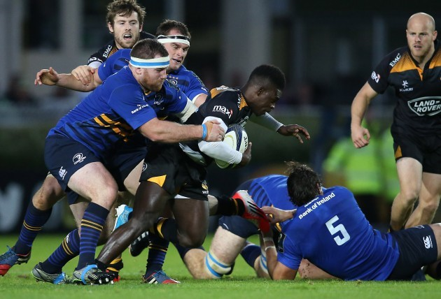 Wasps Christian Wade is tackled by LeinsterÕs Michael Bent and Rhys Ruddock