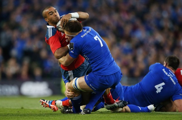 Simon Zebo is tackled by Dominic Ryan
