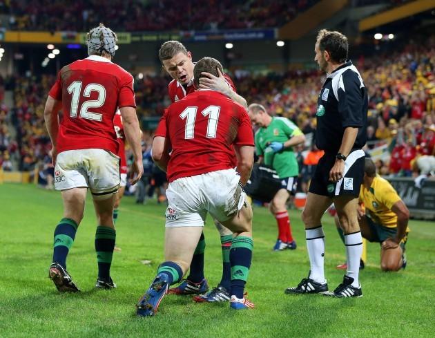 Brian O'Driscoll congratulates George North on scoring a try