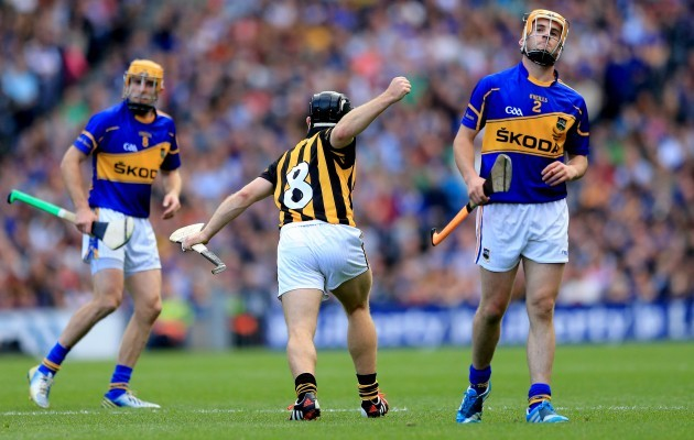 Shane MCGrath and Cathal Barrett dejected as Richie Hogan celebrates scoring a point