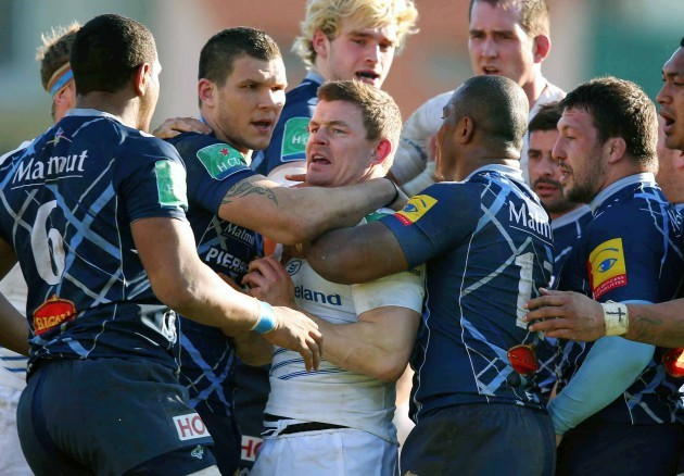Brian O'Driscoll surrounded by Castre's players