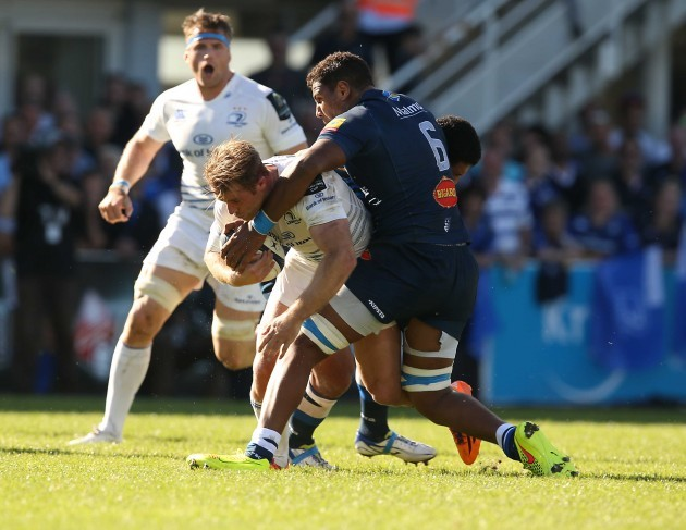 Luke Fitzgerald is tackled by Piula Faasalele