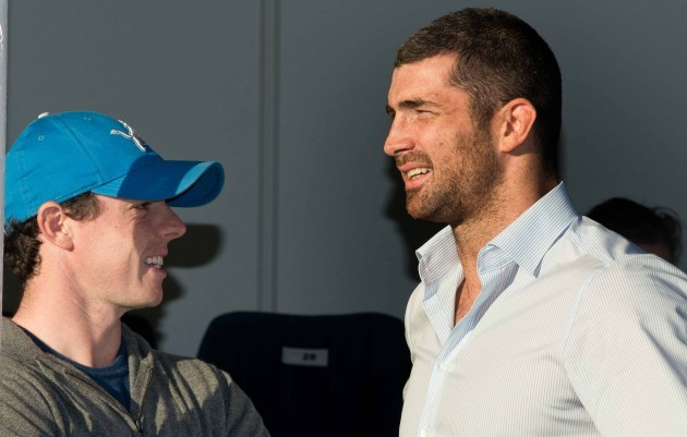 Rory McIlroy chats with the injured Rob Kearney before the game