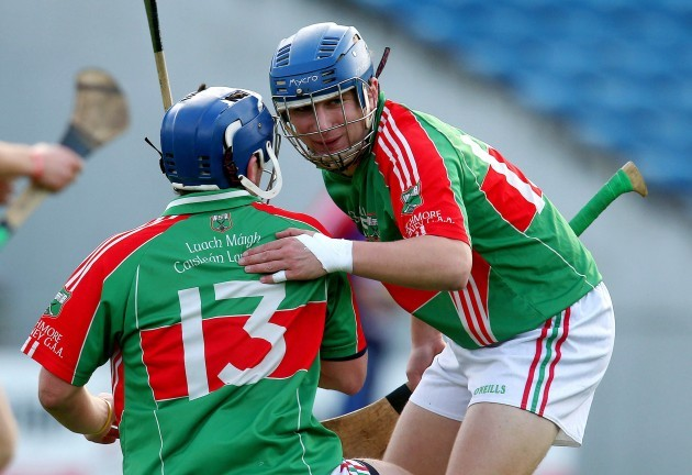 Liam McGrath is congratulated by Cian Hennessy after scoring