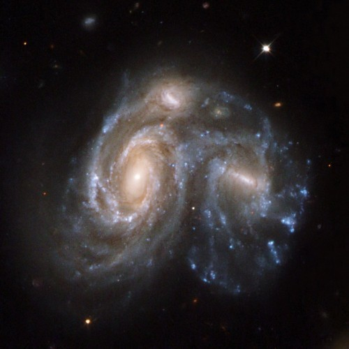this-spectacular-snapshot-in-time-shows-two-galaxies-in-the-process-of-merging-together-it-is-part-of-a-series-of-59-images-released-in-2008-showing-different-stages-of-galaxy-merging-before-during-and-after-this-