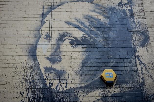 Banksy's Girl with a Pierced Eardrum - Bristol