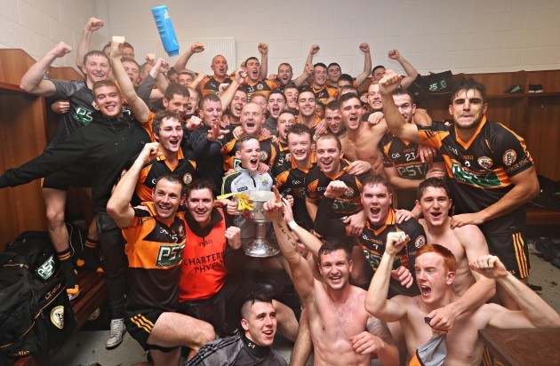 Austin Stacks players celebrate with the cup