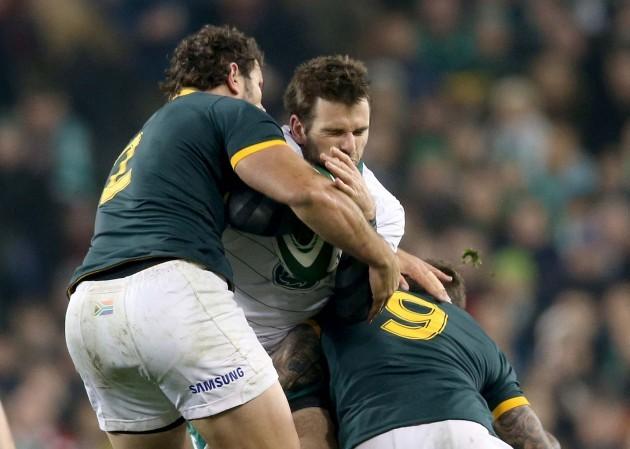 Jared Payne tackled by Bismarck du Plessis and Francois Hougaard