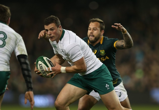 Robbie Henshaw is tackled by Francois Hougaard