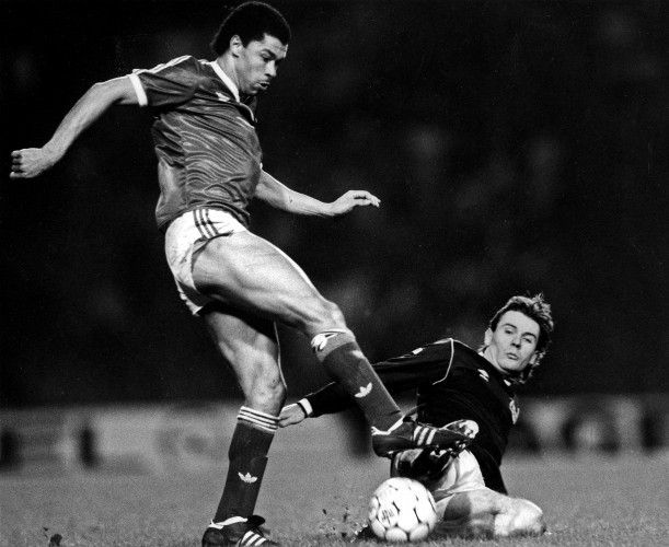 Paul McGrath is tackled by Brian McClair