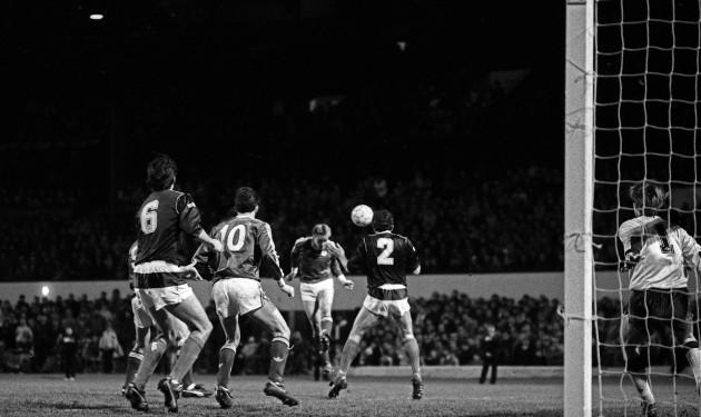 John Byrne heads towards goal