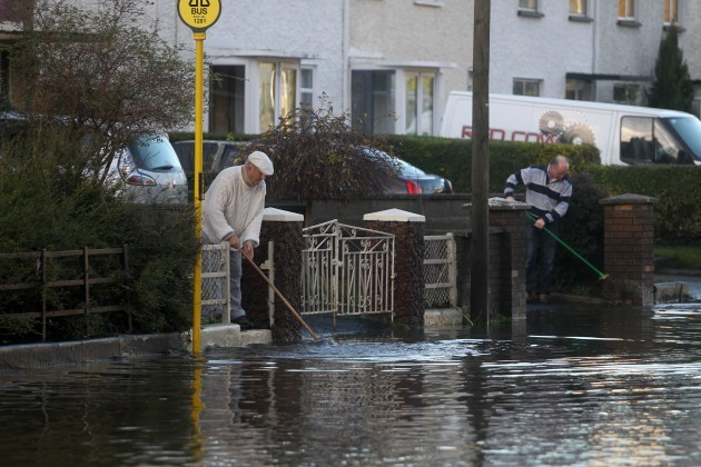14/11/2014. Dublin Floods. Pictured people sweep f