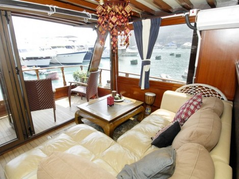float-in-a-chinese-teak-wood-boat-in-hong-kong