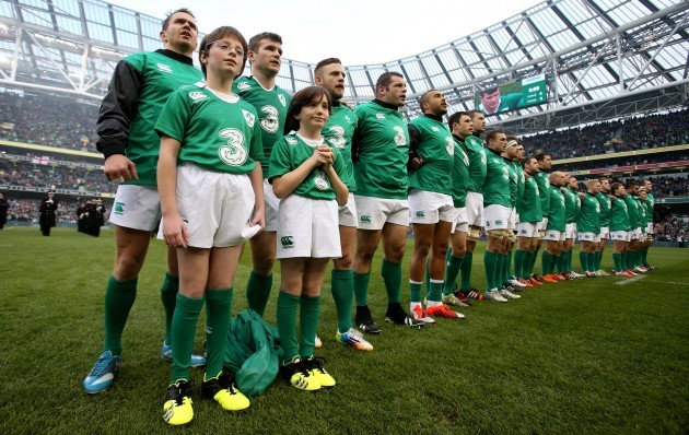 Eoin Reddan with the mascots and the Irish team stand for the national anthem