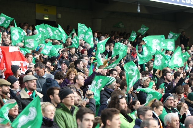 General view of fans waving flags at the game