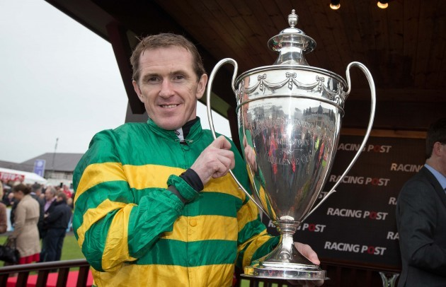 Tony McCoy celebrates with the trophy after winning
