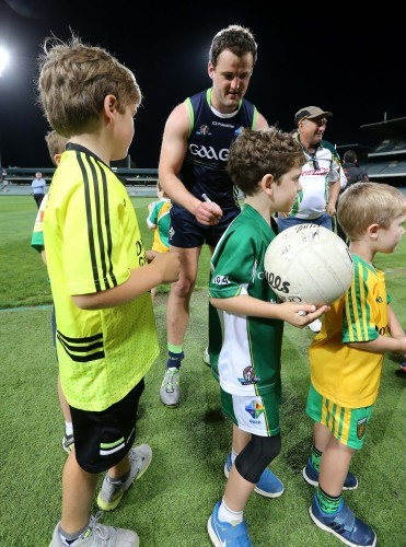 Michael Murphy signs autographs for supporters