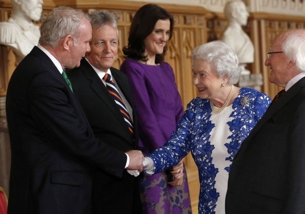 Britain's Queen Elizabeth greets Northern Ireland's Deputy First Minister McGuinness, First Minister Robinson and Britain's Secretary of State for Northern Ireland Villiers during a reception at Windsor Castle