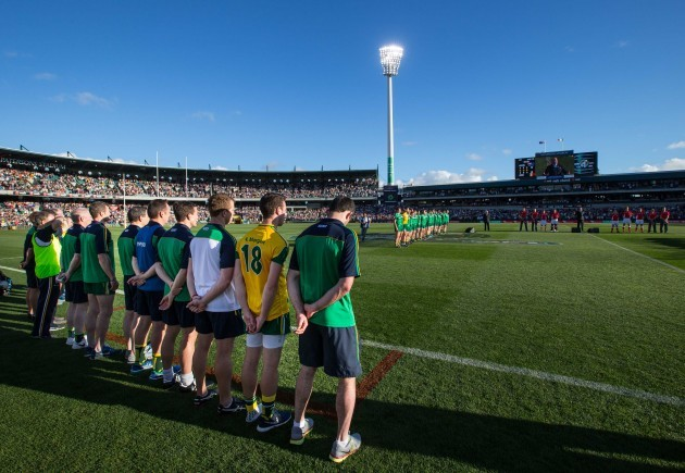 The Ireland management stand for the national anthem