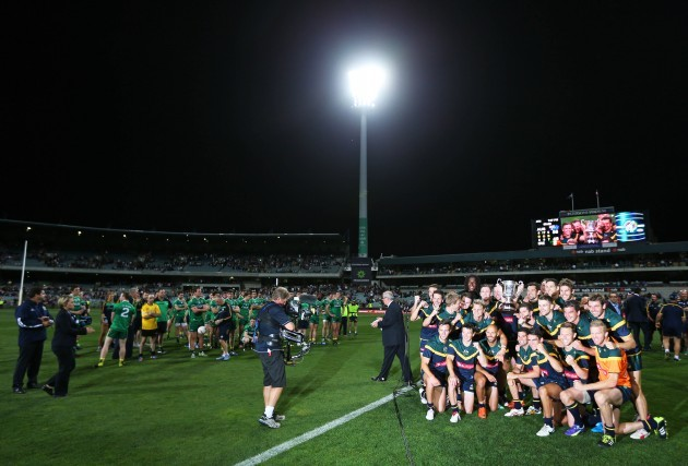 Australia players celebrate with the Cormac McAnallen Cup
