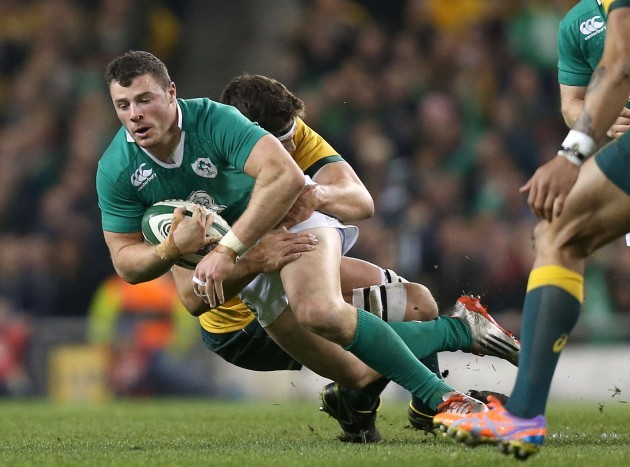 Robbie Henshaw is tackled by Luke Jones
