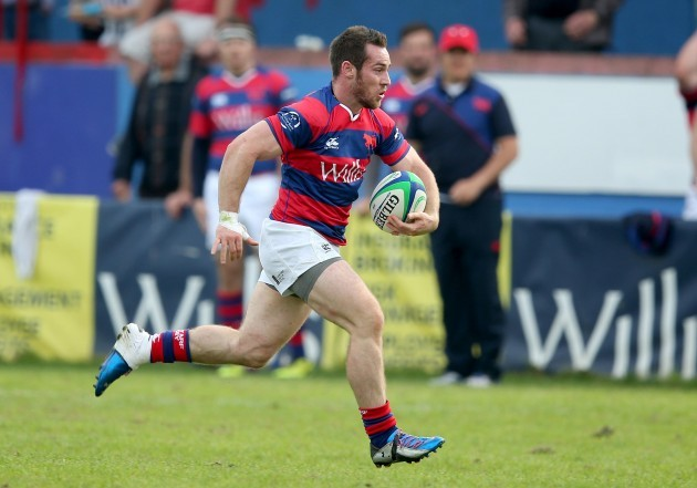Rob McGrath runs in for a try