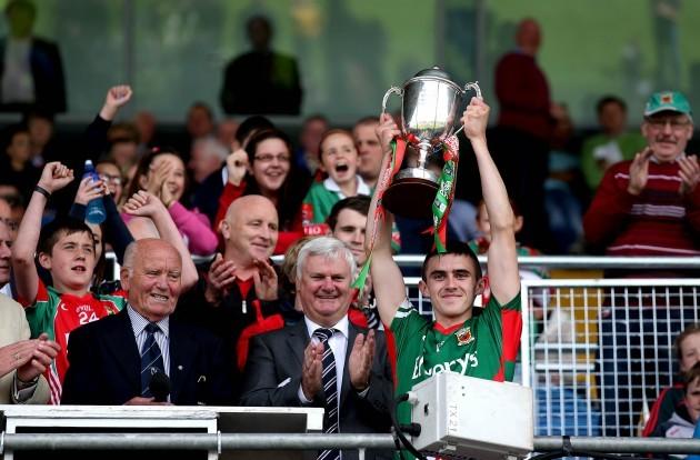 Cian Hanley lifts the trophy