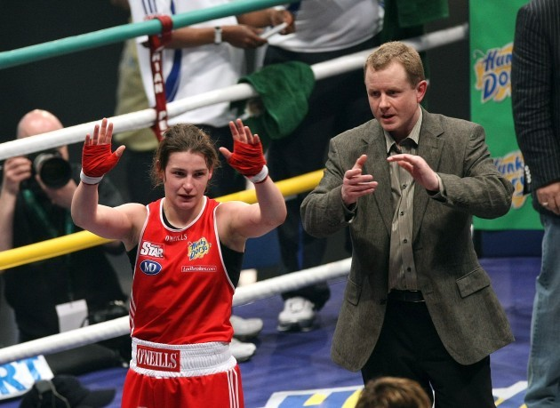 Katie Taylor (RED) celebrates winning her fight