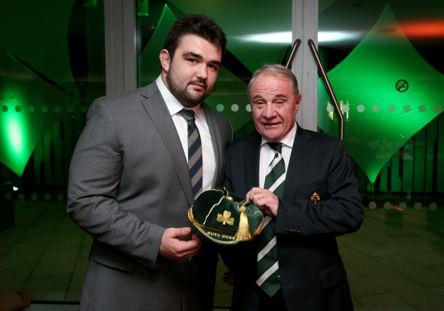 Martin Moore receives his first cap from Pat Fitzgerald