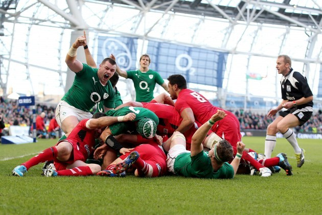 Cian Healy celebrates as Chris Henry scores a try