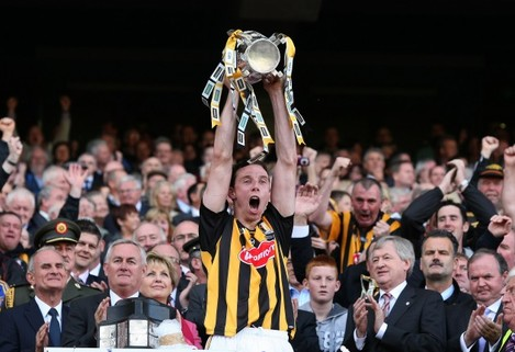 Brian Hogan lifts the Liam McCarthy cup