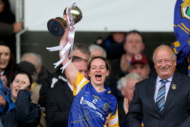 Feena Beirne lifts the cup