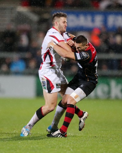 Stuart McCloskey is tackled by Jason Tovey