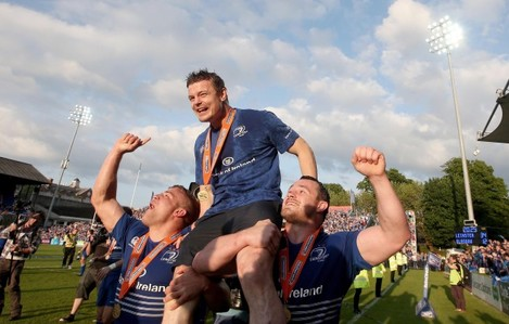 Ian Madigan and Cian Healy carry Brian O'Driscoll after the game