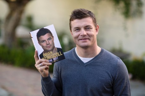 Brian O'Driscoll with a copy of his new book The Test