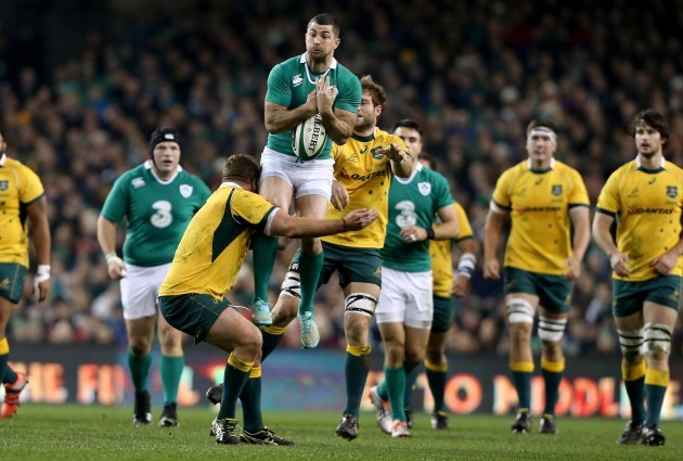 Rob Kearney tackled by James Slipper