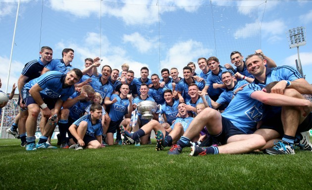 The Dublin team celebrate in front of Hill 16