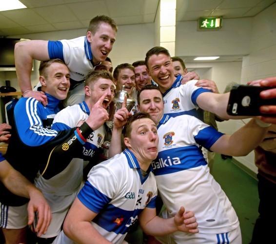 The Vincent's team celebrate in the dressing room after the game