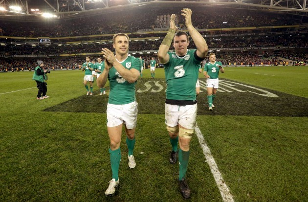 Tommy Bowe and Peter O'Mahony celebrate after the game