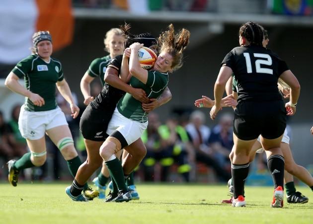 Grace Davitt  tackled by Rawinia Everitt